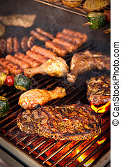 Steak on BBQ - Steak and other Meat on a BBQ