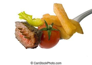 steak on fork - steak, franch fries, cherry tomato and ...