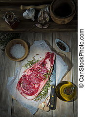 Steak on the table of the kitchen