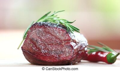 Steak, rosemary and chili pepper. Barbecue beef close up.