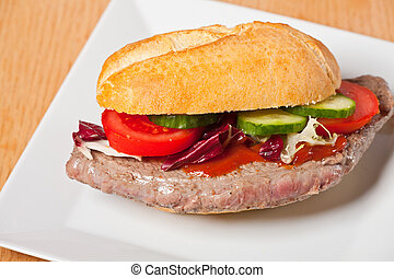 steak sandwich on a white plate