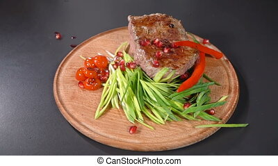 Steak served with leeks and hot peppers. slow motion -...