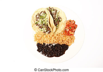 Steak soft tacos with Mexican rice, black beans, and fresh...
