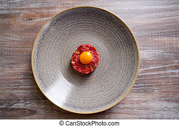 Steak Tartare raw meat recipe with egg yolk