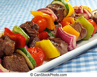 Juicy steak kebabs with bell peppers, onions, zucchini, and cherry tomatoes