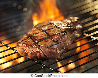 steak with cooking on grill