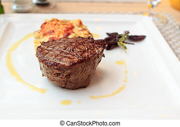 Steak with gratin on a plate