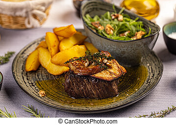 Steak with grilled duck liver