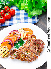 Steak with grilled vegetables on a plate