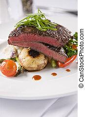 Steak with mushrooms and potato bake