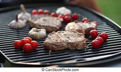 Steaks are fried on the grill.