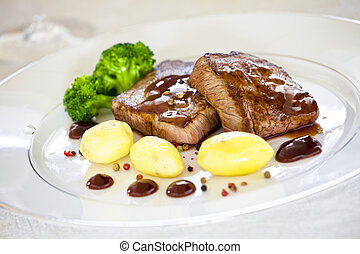 Steaks - Close up photograph of a gourmet dish with steaks...