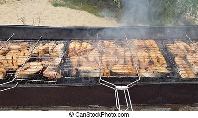steaks from salmon on a grill - a lot of steaks from salmon...