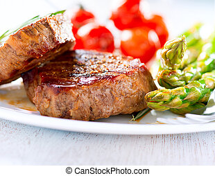 Steaks. Grilled Beef Steak Meat with Vegetables