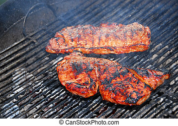 Steaks on barbeque