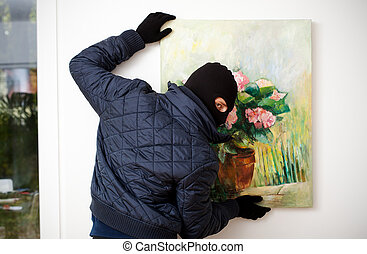 Stealing the work of art. - Thief stealing the piece of art ...