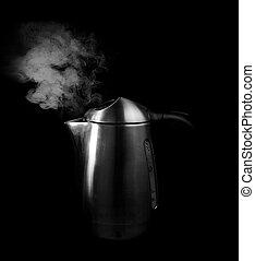 boiling water - steam against black background and boiling ...