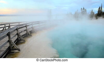 Steam and boardwalk by a geyser