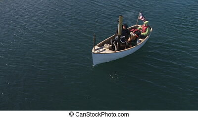 Steam Boat 1 - Small antique steam-powered boat maneuvering...