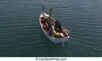 Steam Boat 2 - Small antique steam-powered boat maneuvering...