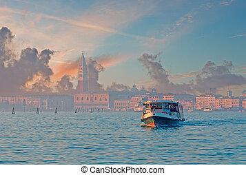 steam boat in Venice lagoon at dusk