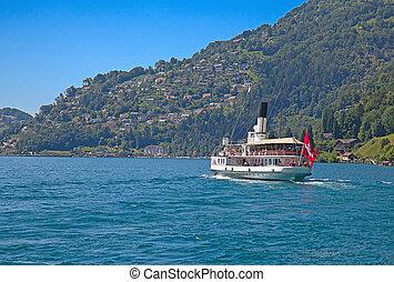 Steam boat cruising swiss lake