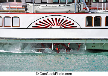 Steam boat wheel. - Steam boat moves on the lake water...