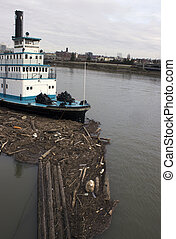 Steam boat with driftwood - A steam boat in the Willamette...