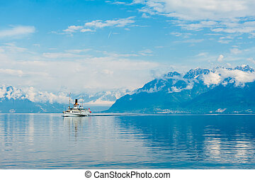 Steam boat with swiss flag floating on the lake Geneva