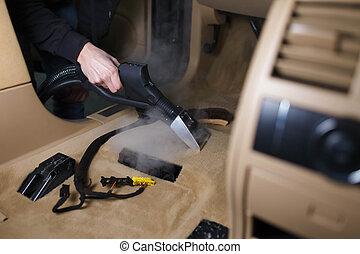 Steam cleaning a car floor
