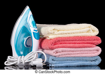 Steam iron and cotton towels isolated