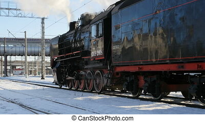 steam locomotive at station