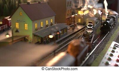 Steam locomotive model train. Scale model railway layout with steam locomotives. Model train station in miniature.