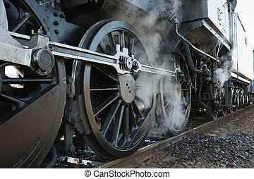 Steam Locomotive - Steam locomotive rolling by close