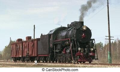 Old steam locomotive train begins it's journey