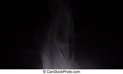 Steam or smoke with small fire at black background