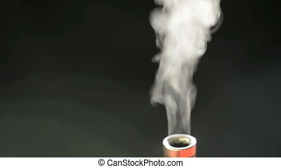 Steam or water vapour coming out of a small toy chimney