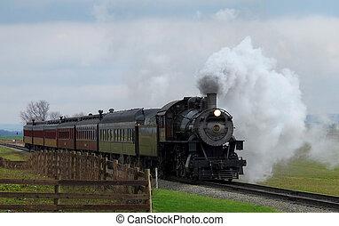 An old time steam passenger train