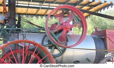 steam power - steam engine powers a pulley and belts