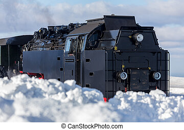 steam train in the snow