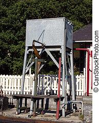 Steam train water tank. - A grey metal steam train water...
