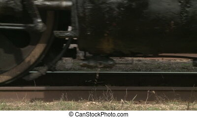 Steam train wheels - Closeup of wheels of an antique...