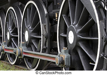 Steam train wheels.