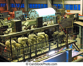 steam turbine during repair, machinery, pipes, tubes at a power plant, night scene