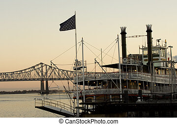 Steamboat on Mississippi river in New Orleans at sunset time