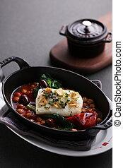 Steamed Atlantic cod saffron braised with bean on black stew
