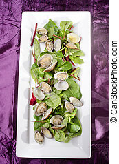 steamed clams with salad on a plate