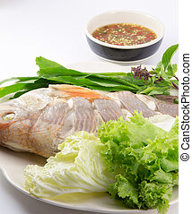 Steamed Fish with vegetables and sauce on white background
