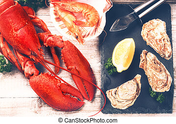Steamed lobster, oysters and shrimps as fine selection of crustacean