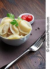 Steamed meat dumplings, traditional pelmeni or varenyky dish